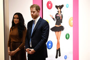 Prince Harry, Duke of Sussex and Meghan, Duchess of Sussex react as they view a special exhibition of art by Indigenous Canadian artist, Skawennati, in the Canada Gallery during their visit to Canada House in thanks for the warm Canadian hospitality and support they received during their recent stay in Canada, on January 7, 2020 in London, England.