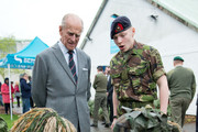 Britain's Prince Philip, Duke of Edinburgh meets cadets during a visit to the Windsor Sea Cadet Unit on April 7, 2014 in in Windsor, England. T.S Windsor Castle is the oldest unit in the Sea Cadet Corps, established in 1899 as a way to provide a small training vessel on the river at Windsor.