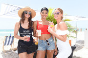 Myla De Blasio, Danielle Herrington and Haley Kalil attend the Duke Spirits And Sports Illustrated Mix Off At The Model Mixology Competition at W South Beach on July 14, 2019 in Miami Beach, Florida.