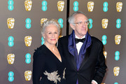 Glenn Close (L) and Jonathan Pryce attend the EE British Academy Film Awards at Royal Albert Hall on February 10, 2019 in London, England.