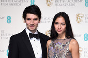 Colin Morgan and Sonoya Mizuno pose in the winners room at the EE British Academy Film Awards at the Royal Opera House on February 14, 2016 in London, England.