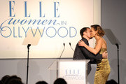 Actor Sam Rockwell and honoree Hilary Swank onstage at ELLE's 17th Annual Women in Hollywood Tribute at The Four Seasons Hotel on October 18, 2010 in Beverly Hills, California.