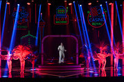 """Cast members perform with a hologram of Elvis Presley during the """"EXTRAVAGANZA - The Vegas Spectacular"""" show at the Jubilee Theater at Bally's Las Vegas Hotel & Casino on November 28, 2020 in Las Vegas, Nevada. The production opened on March 14, 2020, for only one show before all entertainment on the Las Vegas Strip was shut down to fight the coronavirus (COVID-19) pandemic. The show reopened this week just as a three-week statewide pause went into effect due to surging COVID-19 numbers, forcing producers to adjust to new capacity restrictions limiting audience sizes to 50 people."""