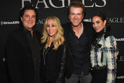Scott Borchetta and Sandi Spika Borchetta of the Big Machine Label Group, Joe Don Rooney of Rascal Flatts, and Tiffany Fallon attend SiriusXM presents the Eagles in their first ever concert at the Grand Ole Opry House on October 29, 2017 in Nashville, Tennessee.