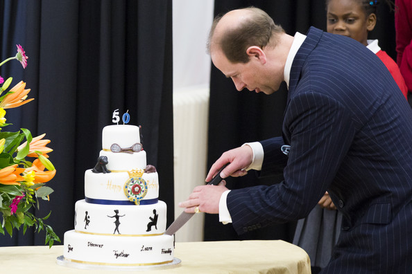 Prince Edward, Earl of Wessex cuts a birthday cake during an official visit on his 50th Birthday at Robert Browning Primary School on March 10, 2014 in London, England.