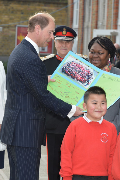 Prince Edward, Earl of Wessex  is presented with a 50th birthday card during an official visit on the Earl's 50th Birthday to Robert Browning Primary School in Walworth to see the work of youth charity Kidscape, recipients of grants from the Wessex Youth Trust, on March 10, 2014 in London, United Kingdom.