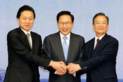 In this handout image supplied by Presidential House (L to R) Japanese Prime Minister Yukio Hatoyama, South Korean President Lee Myung-Bak and Chinese Premier Wen Jiabao pose before the  East Asian 3 Nations Summit on May 29, 2010 in Jeju, South Korea. China came under intensified pressure from South Korea and Japan today to join global efforts to punish North Korea over the sinking of a South Korean warship in March.