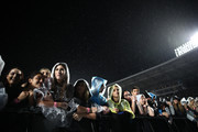 Fans in the front row wait in the rain for the Ed Sheeran concert at Mt Smart Stadium on March 24, 2018 in Auckland, New Zealand.
