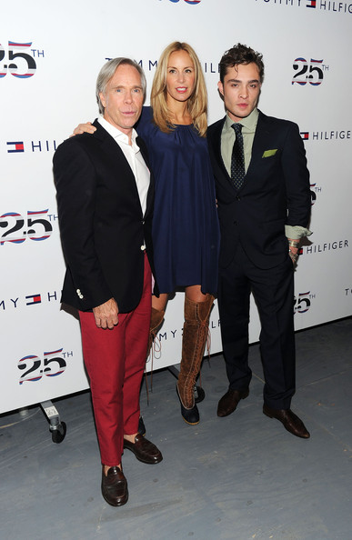 Ed Westwick Designer Tommy Hilfiger, Dee Ocleppo, and actor Ed Westwick pose at the Tommy Hilfiger Spring 2011 fashion show during Mercedes-Benz Fashion Week at The Theater at Lincoln Center on September 12, 2010 in New York City.