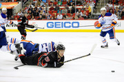 David Perron #57 of the Edmonton Oilers draws a two minute hooking penalty as he takes down Alexander Semin #28 of the Carolina Hurricanes during their game at PNC Arena on March 16, 2014 in Raleigh, North Carolina.