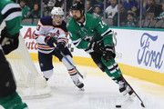 Jamie Benn #14 of the Dallas Stars skates the puck against the Edmonton Oilers in the second period at American Airlines Center on January 6, 2018 in Dallas, Texas.