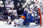 Milan Lucic #27 of the Edmonton Oilers is stopped by Thomas Greiss #1 of the New York Islanders during the third period at the Barclays Center on November 7, 2017 in the Brooklyn borough of New York City.  The Oilers defeated the Islanders 2-1 in overtime.