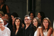 (L-R) Ali Hewson, Bono, Jordan Hewson and Christy Turlington Burns are seen  at the Edun fashion show during Mercedes-Benz Fashion Week Spring 2014 at Skylight Modern on September 8, 2013 in New York City.