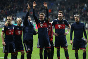 Thomas Mueller of Bayern Muenchen (25) and players of Muenchen celebrate after the Bundesliga match between Eintracht Frankfurt and FC Bayern Muenchen at Commerzbank-Arena on December 9, 2017 in Frankfurt am Main, Germany.