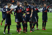 Thomas Mueller of Bayern Muenchen (2nd left) and players of Muenchen celebrate after the Bundesliga match between Eintracht Frankfurt and FC Bayern Muenchen at Commerzbank-Arena on December 9, 2017 in Frankfurt am Main, Germany.