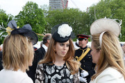 Princess Beatrice (centre) talks to guests during a garden party at Buckingham Palace on May 24, 2016 in London, England.