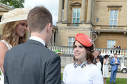 Princess Eugenie (right) talks to guests during guests attending a garden party at Buckingham Palace on May 24, 2016 in London, England.