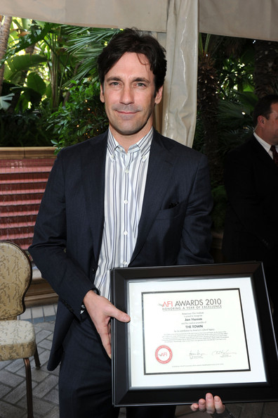 "Actor Jon Hamm poses with ""Year of Excellance"" Award for ""The Town"" at the Eleventh Annual AFI Awards presentation at the Four Seasons Hotel on January 14, 2011 in Los Angeles, California."
