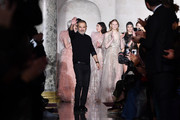 Elie Saab aknwoledges applause on the runway during the Elie Saab Spring Summer 2018 show as part of Paris Fashion Week on January 24, 2018 in Paris, France.