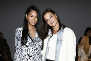 Chanel Iman (L) and Katie Holmes attend the Ellie Tahari front row during New York Fashion Week: The Showsat Gallery II at Spring Studios on September 05, 2019 in New York City.