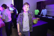 Actor Benjamin Stockham checks out the Dig for Geodes Blacklight Science Room during the Elizabeth Glaser Pediatric AIDS Foundation 26th Annual A Time For Heroes Family Festival at Smashbox Studios on October 25, 2015 in Culver City, California.