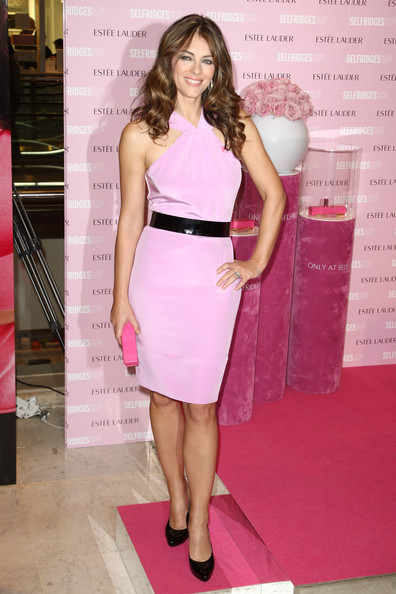 Liz Hurley poses as a spokes model for Estee Lauder Breast Cancer Awareness Month held at Selfridges department store on October 22, 2009 in London, England.