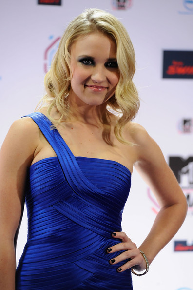 Emily Osment Emily Osment poses in front of the media boards at the MTV Europe Music Awards 2010 at La Caja Magica on November 7, 2010 in Madrid, Spain.