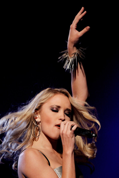 Emily Osment Singer Emily Osment performs at The Dome 55 on August 27, 2010 in Hannover, Germany.