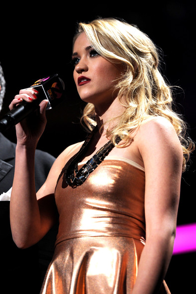 Emily Osment Emily Osment speaks onstage during Z100's Jingle Ball 2010 at Madison Square Garden on December 10, 2010 in New York City.