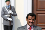 Sheikh Tamim bin Hamad Al Thani, the eighth and current Emir of the State of Qatar, arrives to meet with German President Joachim Gauck (not pictured) at Bellevue Palace on September 17, 2014 in Berlin, Germany. The Qatari monarch, known for his support of sporting events and his position as head of the Qatar Investment Authority board of directors, is visiting Berlin and Bavaria on his trip to the country.