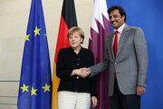 Sheikh Tamim bin Hamad Al Thani, the eighth and current Emir of the State of Qatar (R), shakes hands with German Chancellor Angela Merkel after a press conference on September 17, 2014 in Berlin, Germany. The Qatari monarch, known for his support of sporting events and his position as head of the Qatar Investment Authority board of directors, is visiting Berlin and Bavaria on his trip to the country.