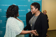 Singer-songwriter Jill Scott (R) and guest attend the Empowering Women Summit at United Nations on May 9, 2016 in New York City.