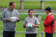 (L-R) Martin Johnson, manager of England talks with Mike Ford, the England defence coach and Brian Smith, the England attack coach during an England IRB Rugby World Cup 2011 training session at Onewa Domain on October 6, 2011 in Auckland, New Zealand.