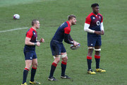 George Kruis (C) passes the ball watched by Mike Brown (L) and Maro Itoje during the England training session held at Pennyhill Park on February 23, 2016 in Bagshot, England.