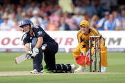 Tim Paine looks on as Luke Wright of England hits out during during the 5th NatWest One Day International between England and Australia at Lords on July 3, 2010 in London, England.