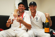 Andrew Flintoff (R) of England poses with Steve Harmison and the Ashes urn in the dressing room after day four of the npower 5th Ashes Test Match between England and Australia at The Brit Oval on August 23, 2009 in London, England.