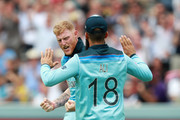 Ben Stokes of England celebrates with team mate Moeen Ali after taking the wicket of Usman Khawaja during the Group Stage match of the ICC Cricket World Cup 2019 between England and Australia at Lords on June 25, 2019 in London, England.