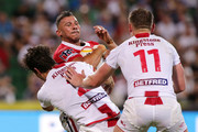 Nabil Djalout of France is tackled by Stefan Ratchford and Ben Currie of England during the 2017 Rugby League World Cup match between England and France at nib Stadium on November 12, 2017 in Perth, Australia.