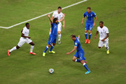 Andrea Pirlo of Italy reacts as Giorgio Chiellini of Italy controls the ball during the 2014 FIFA World Cup Brazil Group D match between England and Italy at Arena Amazonia on June 14, 2014 in Manaus, Brazil.