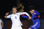 Jill Scott of England and Adila Vyldanova of Kazakhstan during the FIFA Women's World Cup Qualifier between England and Kazakhstan at Weston Homes Community Stadium on November 28, 2017 in Colchester, England.