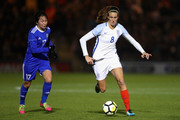 Jill Scott of England and Karina Zhumabaikyzy of Kazakhstan  during the FIFA Women's World Cup Qualifier between England and Kazakhstan at Weston Homes Community Stadium on November 28, 2017 in Colchester, England.