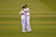 James Anderson and Steve Finn congratulate each other after taking nine New Zealand wickets between them during day three of the 1st Investec Test match between England and New Zealand at Lord's Cricket Ground on May 18, 2013 in London, England.