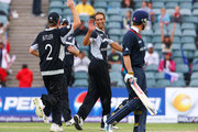 Grant Elliott of New Zealand celebrates taking the wicket of Graeme Swann of England during the ICC Champions Trophy Group B match between England and New Zealand at Wanderers Stadium on September 29, 2009 in Johannesburg, South Africa.