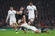 Ben Smith of New Zealand All Blacks is tackled by Ben Youngs of England during the Quilter International match between England and New Zealand at Twickenham Stadium on November 10, 2018 in London, United Kingdom.