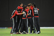 Stuart Broad of England is congratulated by Kevin Pietersen and teammates after dismissing Shahid Afridi of Pakistan to win the 2nd International Twenty20 Match between Pakistan and England at Dubai International Stadium on February 25, 2012 in Dubai, United Arab Emirates.