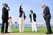 Joe Root of England tosses the coin as Sarfraz Ahmed of Pakistan watches on ahead of play on day one of the 2nd test between England and Pakistan at Headingley on June 1, 2018 in Leeds, England.