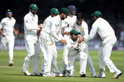 Mohammad Amir of Pakistan celebrates with captain Sarfraz Ahmed after dismissing Dawid Malan of England during day three of the 1st NatWest Test match between England and Pakistan at Lord's Cricket Ground on May 26, 2018 in London, England.