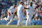 Imran Tahir of South Africa celebrates with AB deVilliers and Hashim Amla after dismissing England captain Andrew Strauss during day four of the 1st Investec Test match between England and South Africa at The Kia Oval on July 22, 2012 in London, England.