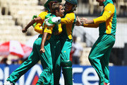 Imran Tahir of South Africa is congratulated by team mates, after he caught and bowled Jonathan Trott of England during the 2011 ICC World Cup match between England and South Africa at M. A. Chidambaram Stadium on March 6, 2011 in Chennai, India.