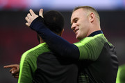 Wayne Rooney of England speaks to Raheem Sterling of England prior to the International Friendly match between England and United States at Wembley Stadium on November 15, 2018 in London, United Kingdom.